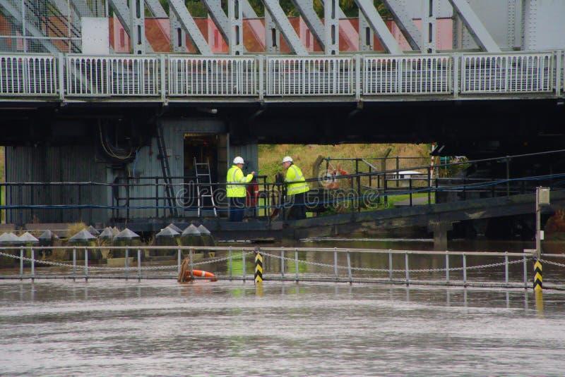 Engineers working below Crosskeys bridge. stock images