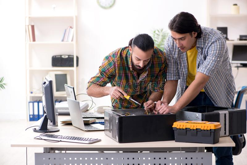 IT engineers working on hardware issue royalty free stock photos