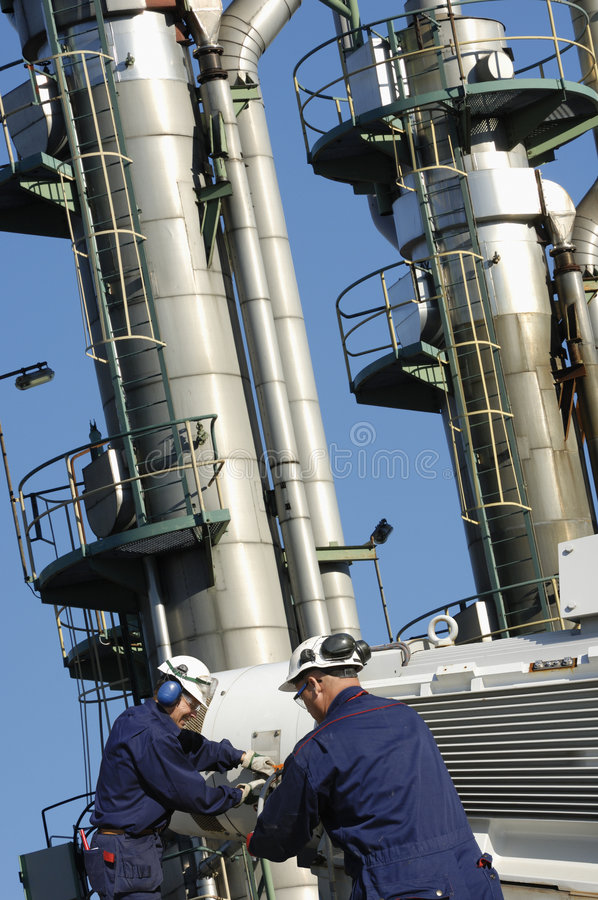 Engineers working inside oil industry royalty free stock images