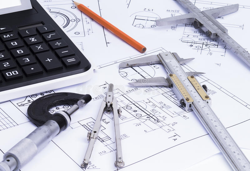 Engineerung tools on technical drawings. The image shows engineering tools on technical drawings stock photo