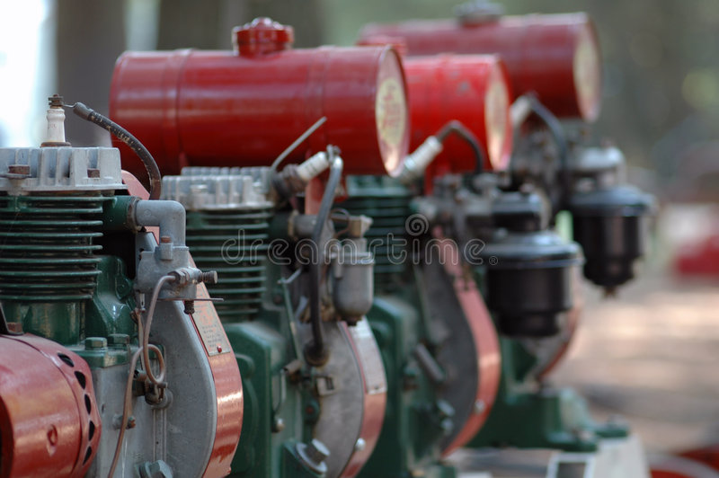 Engines. Row of antique engines stock photography