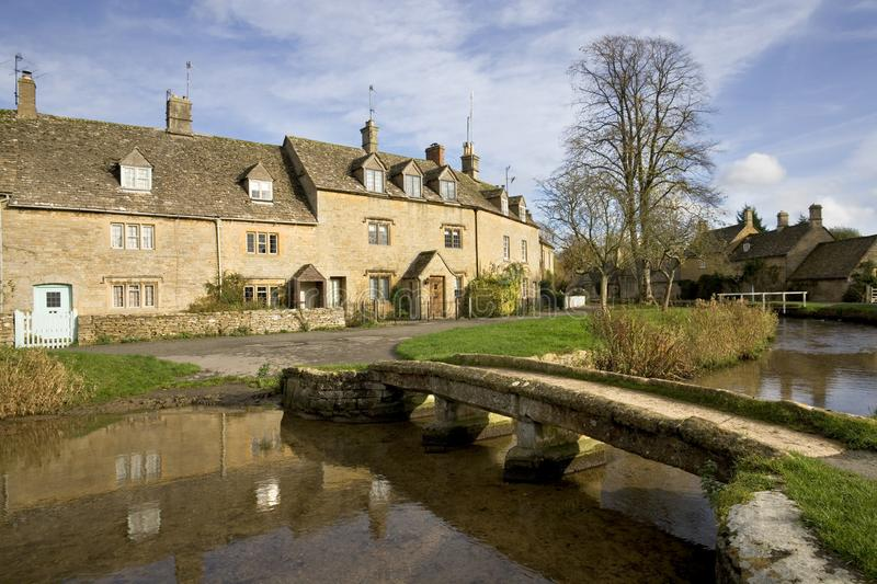 England, Cotswolds, Lower Slaughter. England, Gloucestershire, Cotswolds, Lower Slaughter in autumn, riverside cotswold stone cottages stock photography