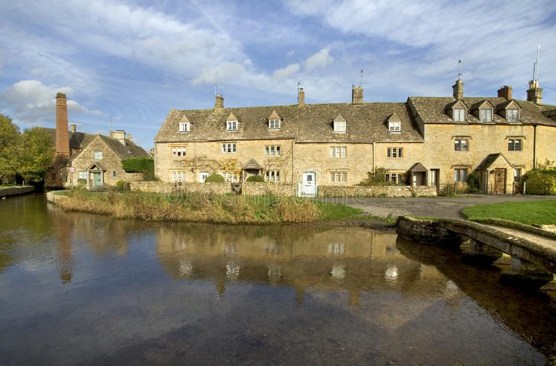 England, Cotswolds, Lower Slaughter. England, Gloucestershire, Cotswolds, Lower Slaughter in autumn, riverside cotswold stone cottages royalty free stock image