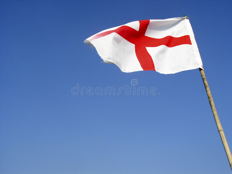 England flag. English flag flying in the wind (with room for text stock photography