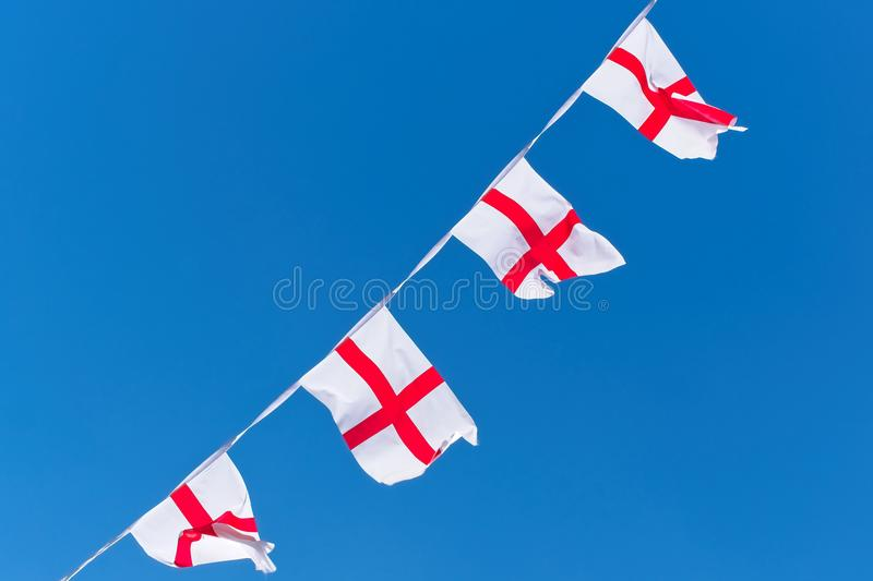 England flags / bunting against blue sky. Concept of sports, team, or festival royalty free stock photography