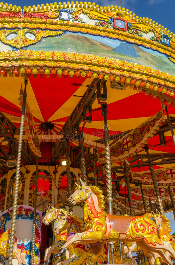 England, Morecambe, 06/15/2014, colourful vintage horse carousel at a Fairground royalty free stock photography