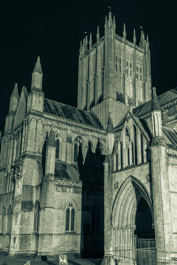 ENGLAND, WELLS - 20 SEP 2015: Wells Cathedral by night, black an. D white photography, split toning B, tower, night photography royalty free stock photos