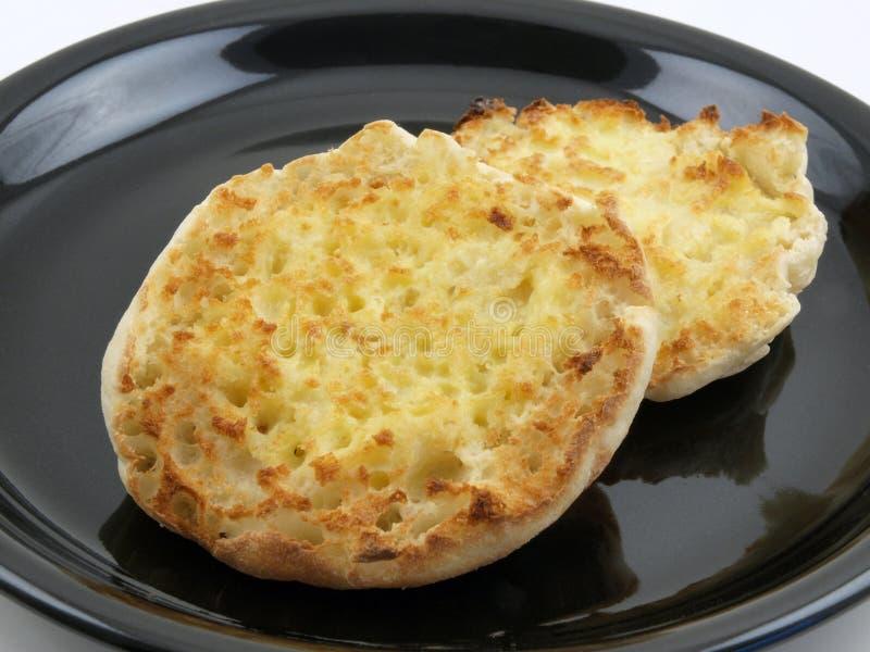 Englisches Muffin mit Butter stockbild