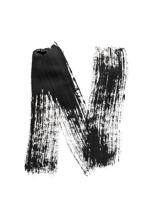 The English alphabet, the letter N. The English alphabet, the letter `N` is written in black paint on a white isolated background. Vertical frame stock image