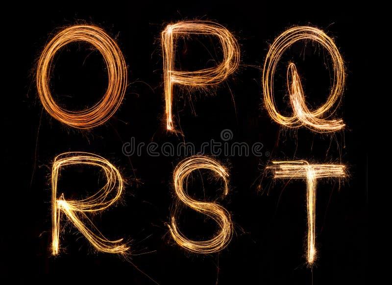 English alphabet. Sparkler firework light alphabet O-T stock photography