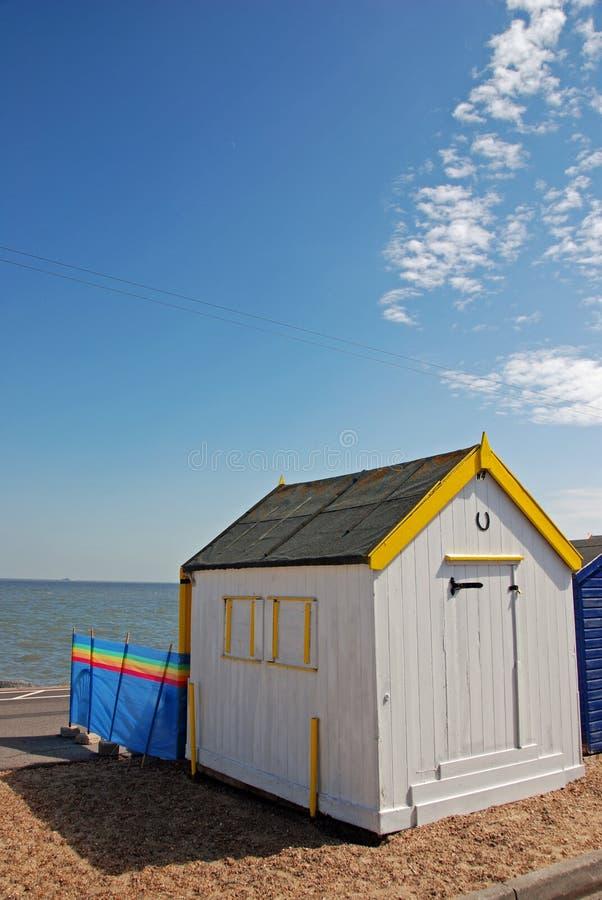 English Beach Hut. White and yellow English beach hut by seaside stock images
