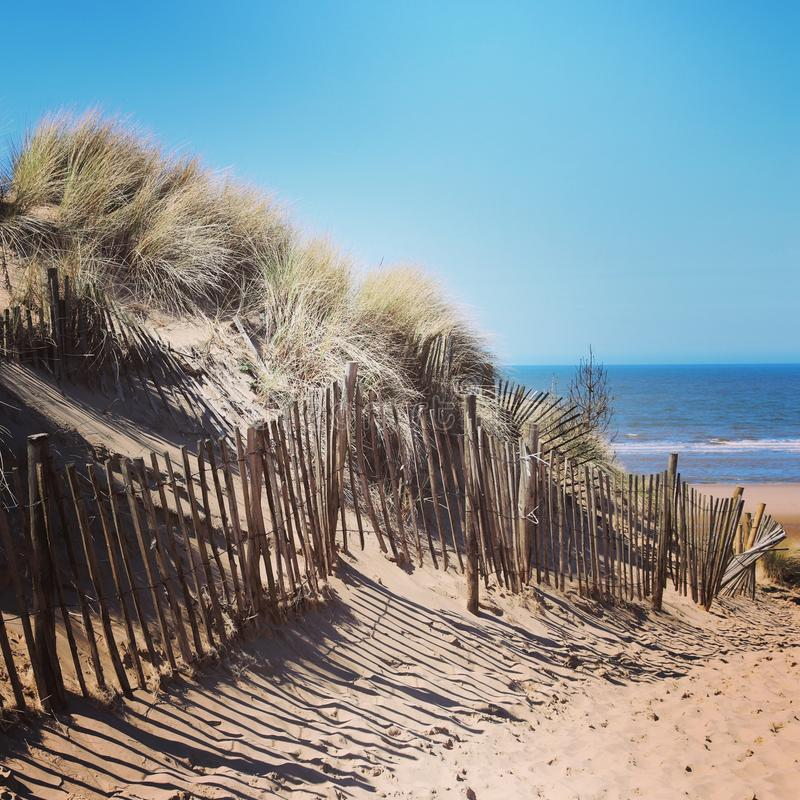 English beach scene. With sun, sand and sea royalty free stock photography