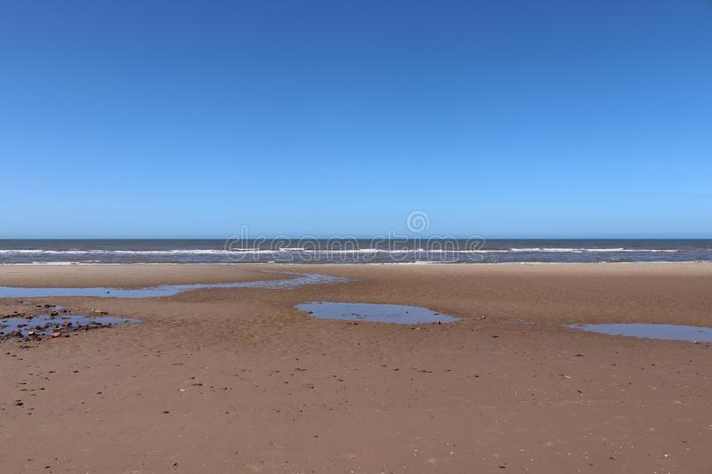 English beach scene. With sun, sand and sea stock images