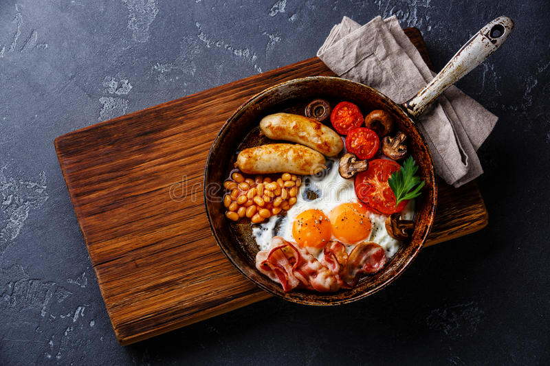 English breakfast in cooking pan royalty free stock images
