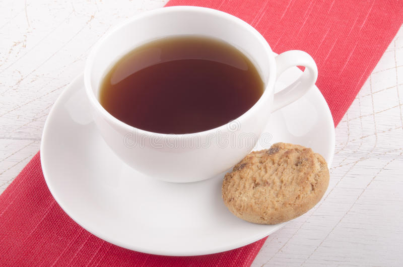 English breakfast tea in a cup. English breakfast tea in a white cup with a biscuit royalty free stock images