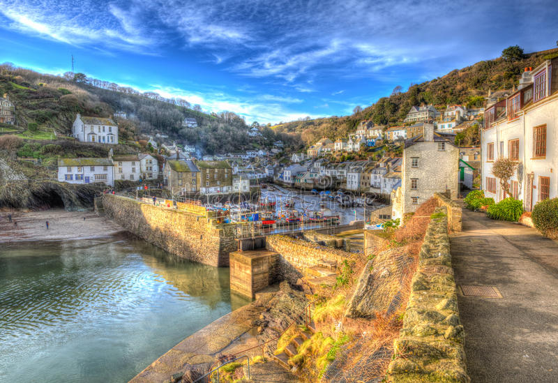 English coast fishing village Polperro Cornwall England with houses and harbour wall in HDR like painting. English south west coast fishing village Polperro royalty free stock image
