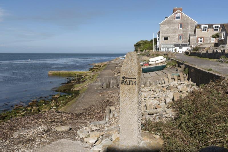 English coastal footpath marker stone. Marker stone for a coastal path close to Peveril Point Swanage Dorset England UK.June 2017 royalty free stock photos