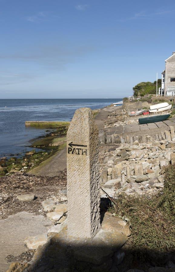 English coastal path and sign. Marker stone for a coastal path close to Peveril Point Swanage Dorset England UK.June 2017 royalty free stock photo