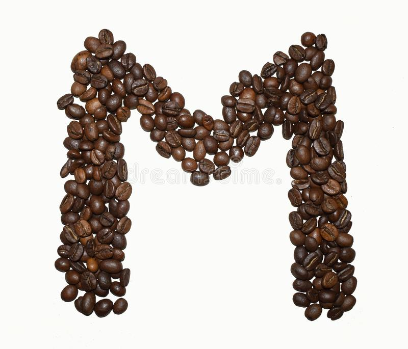 Сoffee letter - M. English Coffee Alphabet isolated on white. Roasted coffee beans. Ð¡offee letter - M, text, drink, food, sign, brown, cafe, background royalty free stock image