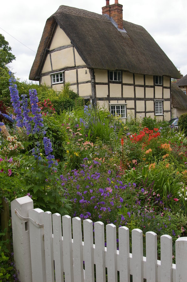 English cottage. Traditional English cottage with beautiful garden royalty free stock photos