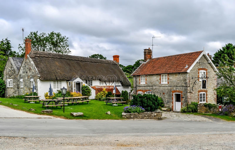 English Country Cottage and pub. An English Country Cottage with a pub attached. The Compasses Inn in Wiltshire England stock image