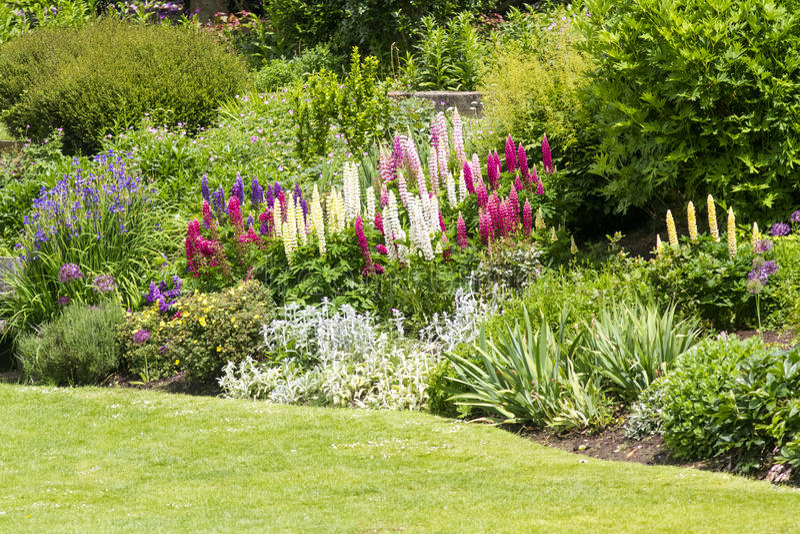 English country formal garden. Idylic pretty english country estate garden in full bloom royalty free stock photos