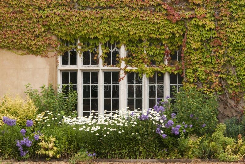 English country garden. English house with country garden stock photos