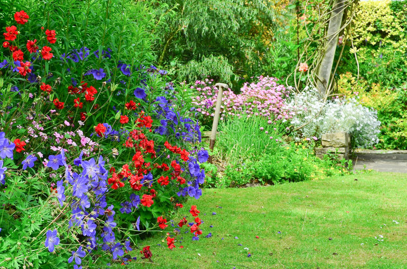 English country garden. Beautiful classic English country garden borders royalty free stock photos