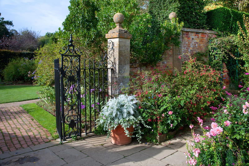English country garden. Fine English country garden with fuchias and delphiniums, Gloucestershire, England stock photos
