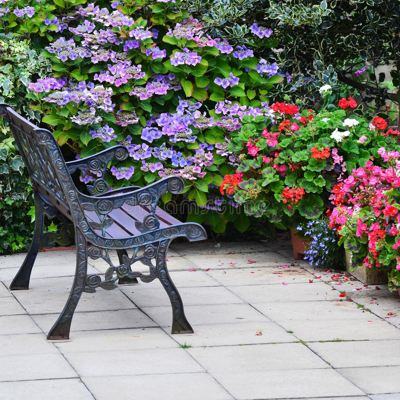 English country garden rustic patio area. A typical English country garden patio area at the end of summer going into autumn stock image