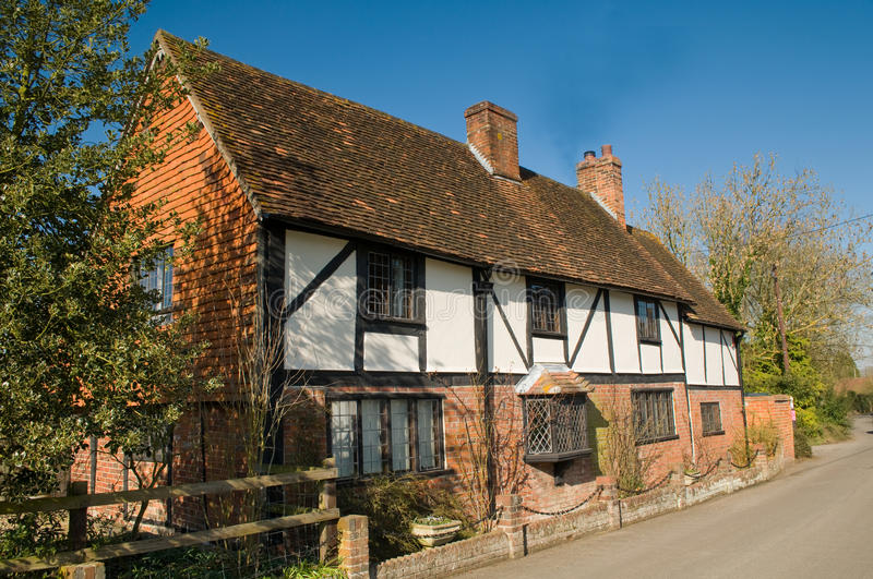 English country house. Traditional English country house cottage Berkshire Tudor black and white beams red brick lead light windows stock photography