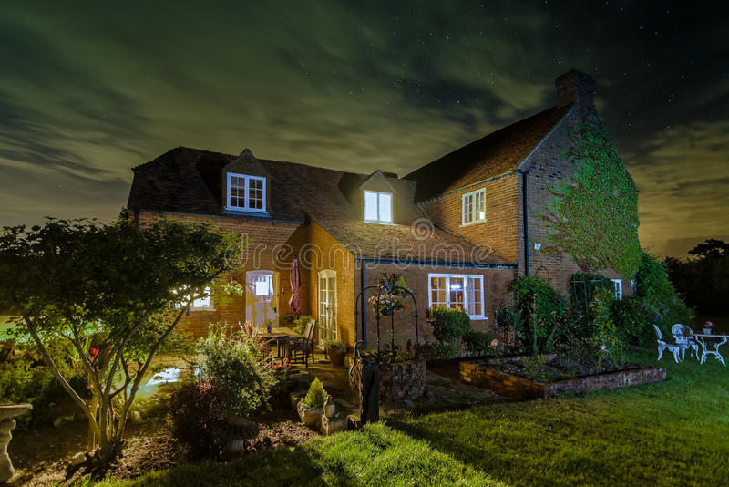 English country house - House Home At Night royalty free stock photos