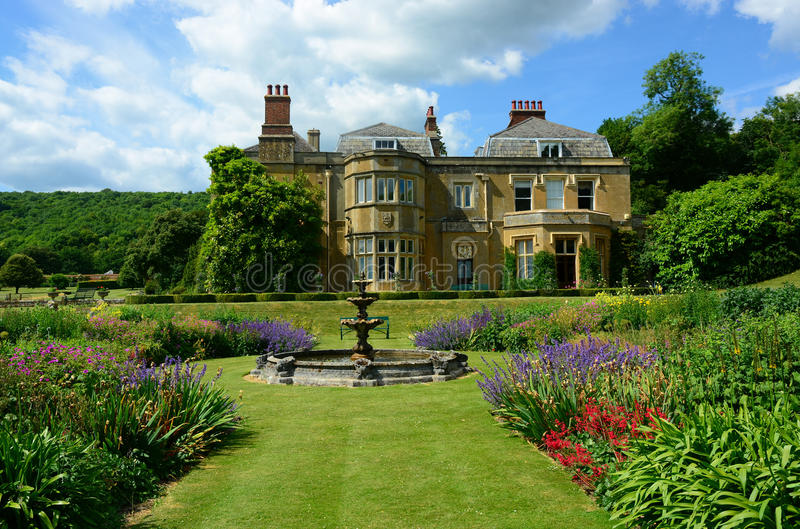 English Country house. Large country house in the heart of the Surrey countryside in England. Lovely formal gardens in summer bloom stock images