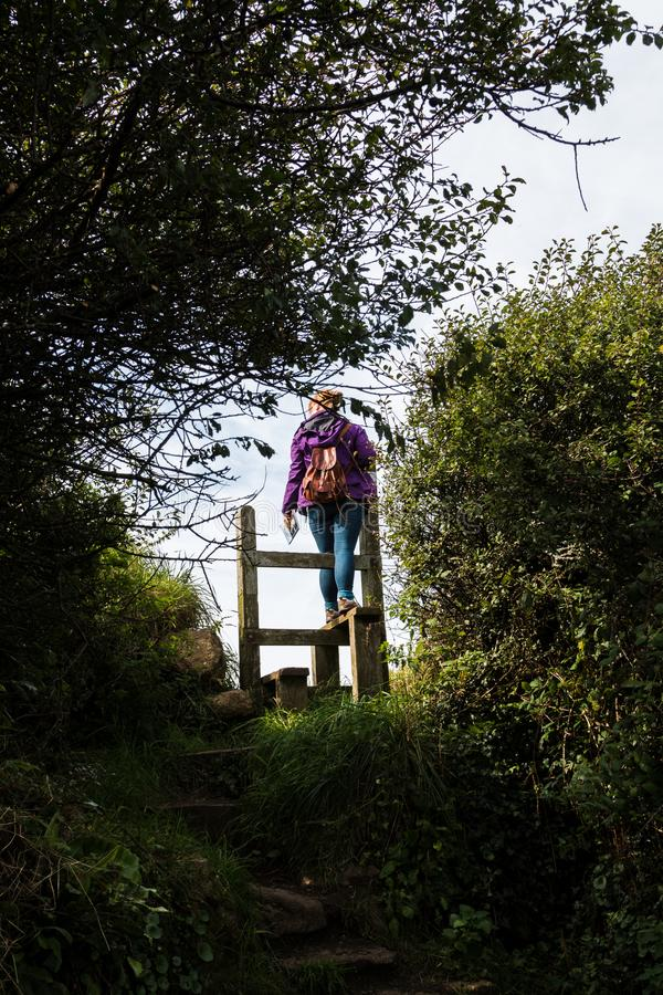 An English country stile with woman stock photo