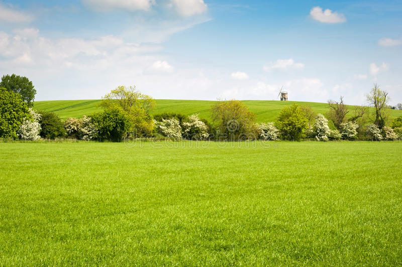 English countryside landscape. With old windmill on the horizon royalty free stock photo