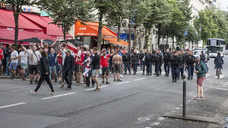 English football supporters are kept in check by the French police after a UEFA Euro 2016 match stock images