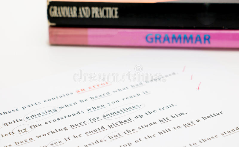 English grammar sheet. Checking red pen on the correct answer stock photography