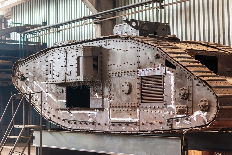 English tank of the first world war, in the factory workshop for restoration. English heavy tank Mark V, of the times of the first world war, in the factory stock photos