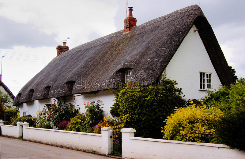 English House With Straw Roof Royalty Free Stock Images