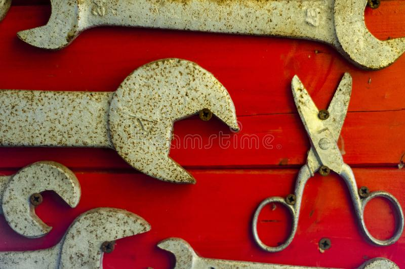 English keys on red background. Old and used english keys on red background royalty free stock photo