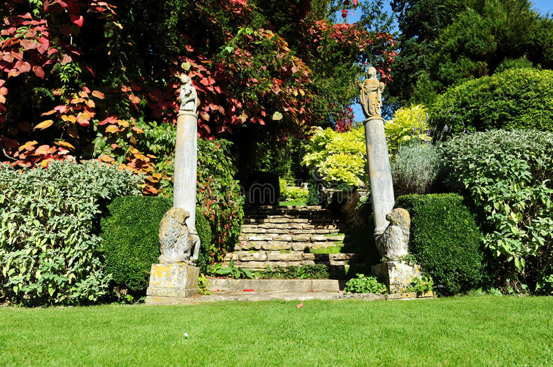 English Landscape Garden. Lawn and Stone Steps in a Peaceful English Landscape Garden royalty free stock photo