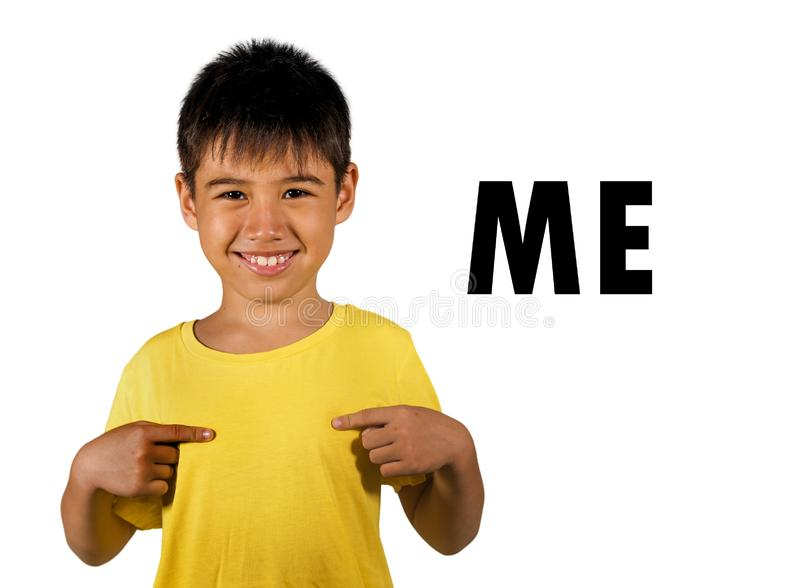 English language learning card child pointing with fingers to himself and the word ME isolated on white background as part of stock photo