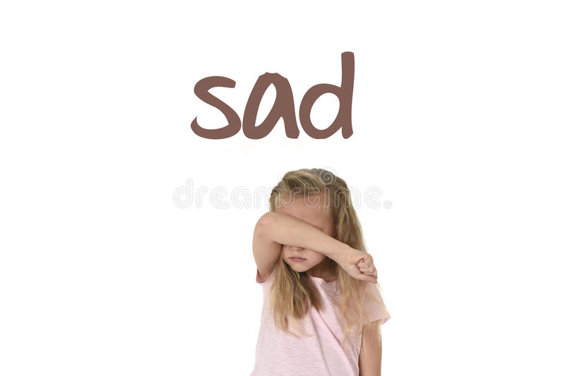 English language learning vocabulary school card with word sad and sweet young little schoolgirl stock photos