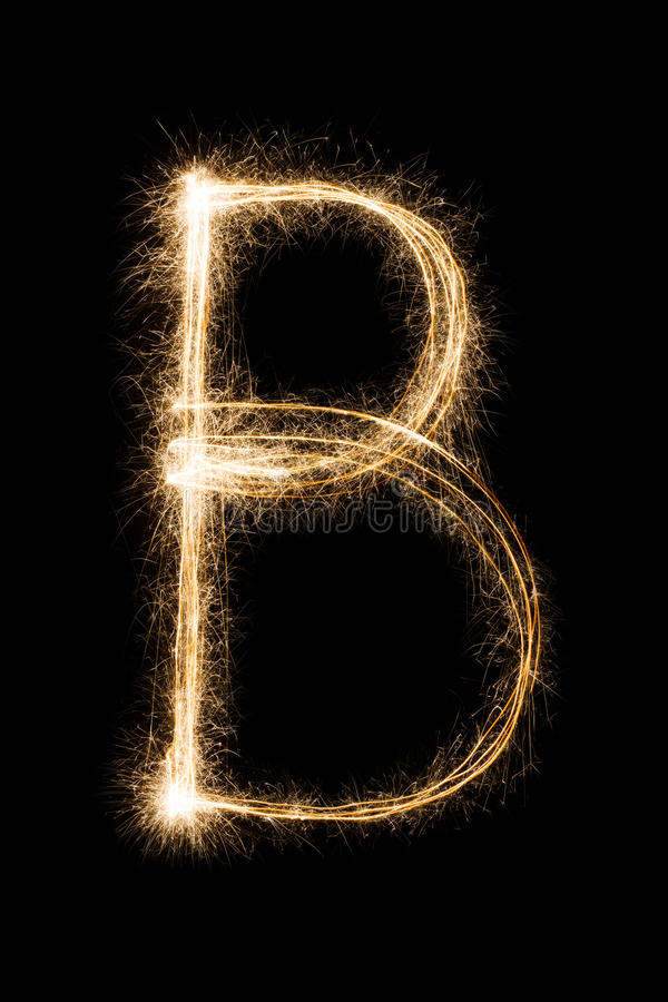 English Letter B from sparklers alphabet on black background. English big Letter B made from burning sparkles on black background. Shiny festive party firework royalty free stock photography