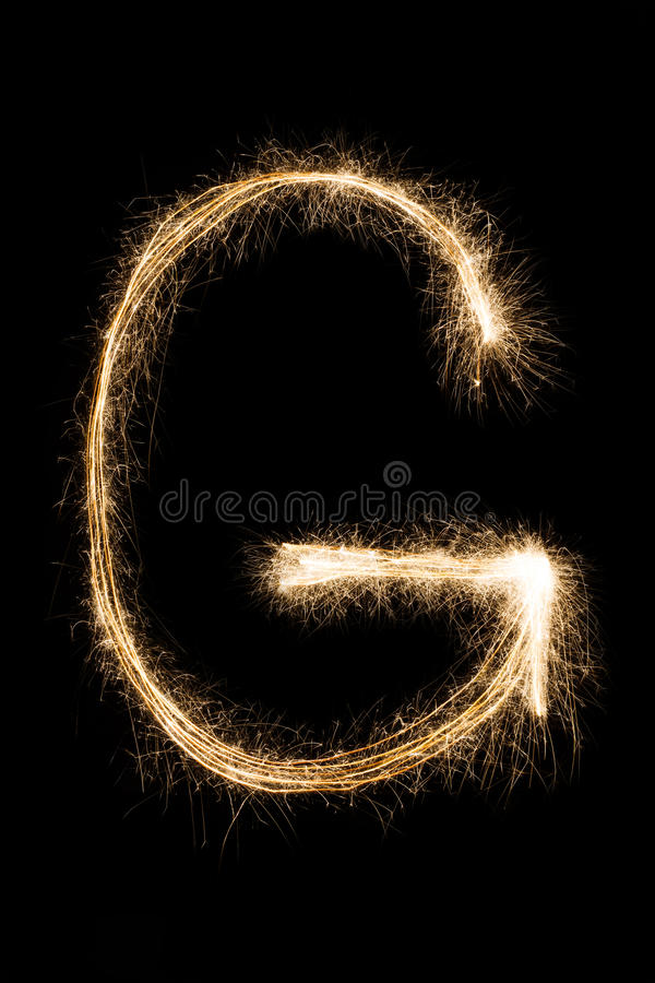 English Letter G from sparklers alphabet on black background. English Letter G made from burning sparkles on black background. Shiny festive firework font stock photos