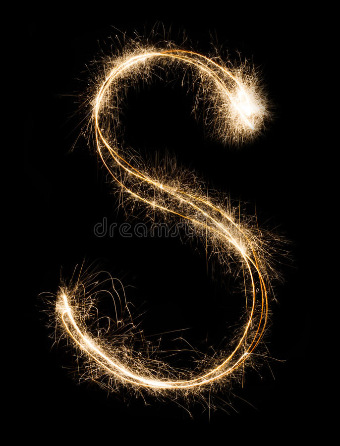 English Letter S from sparklers alphabet on black background. English Letter S made from burning sparkles on black background. Shiny festive firework font stock photography