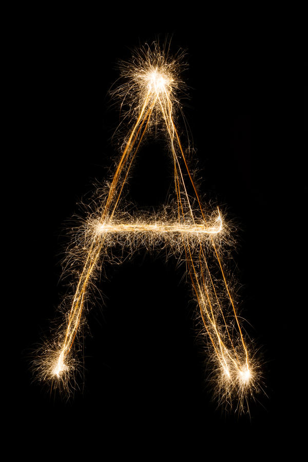 English Letter A from sparklers alphabet on black background. royalty free stock photo