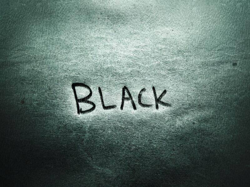 The English letter word black color name on the rough paper page royalty free stock images