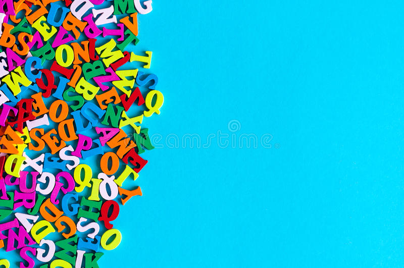 English letters on blue background composed from colorful abc alphabet leter. Back to school concept or Learning english. Or other language courses. Empty space royalty free stock image