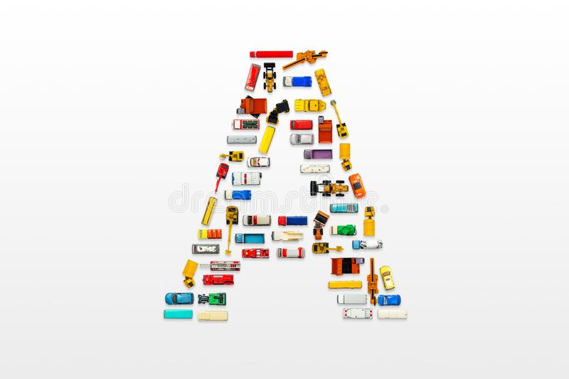 English letters formed by arrangement of Car toy diecast on the stock image